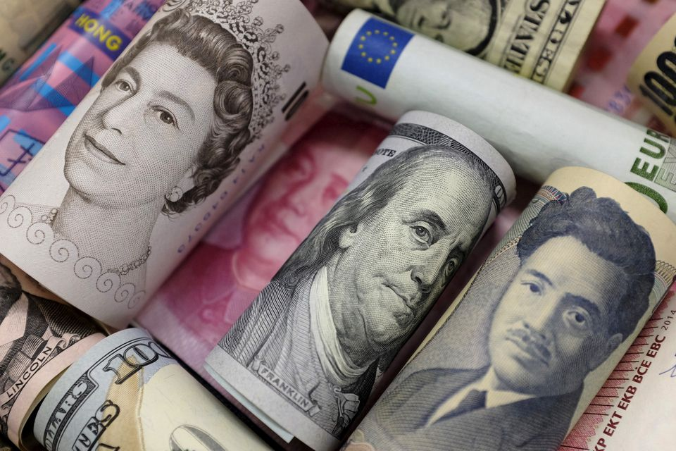 Dollar edges up on manufacturing data after initial softness